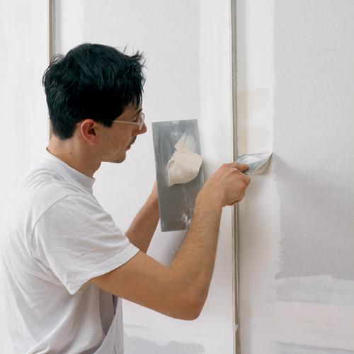 Fase 3 - Revestimiento del panel protegiendo el perfil con un listón de madera